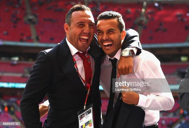 Santi Cazorla of Arsenal and Pedro of Chelsea embrace on the pitch prior to the Emirates FA Cup Final between Arsenal and Chelsea at Wembley Stadium...