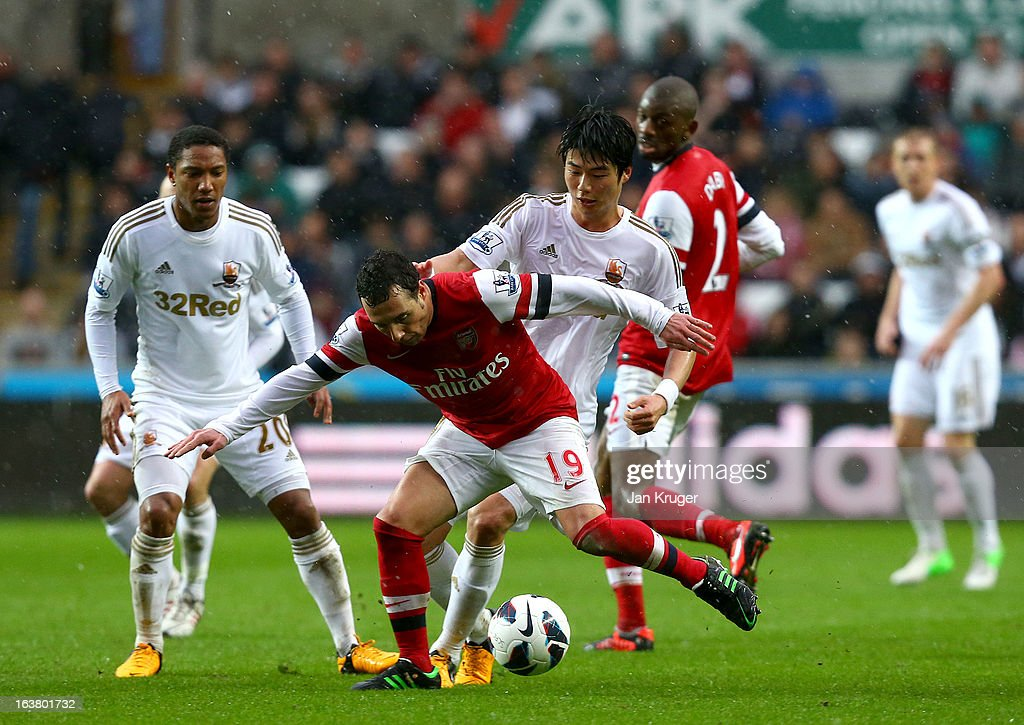 <a gi-track='captionPersonalityLinkClicked' href=/galleries/search?phrase=Santi+Cazorla&family=editorial&specificpeople=709830 ng-click='$event.stopPropagation()'>Santi Cazorla</a> of Arsenal battles with Ki Sung-Yueng of Swansea City during the Barclays Premier League match between Swansea City and Arsenal at Liberty Stadium on March 16, 2013 in Swansea, Wales.