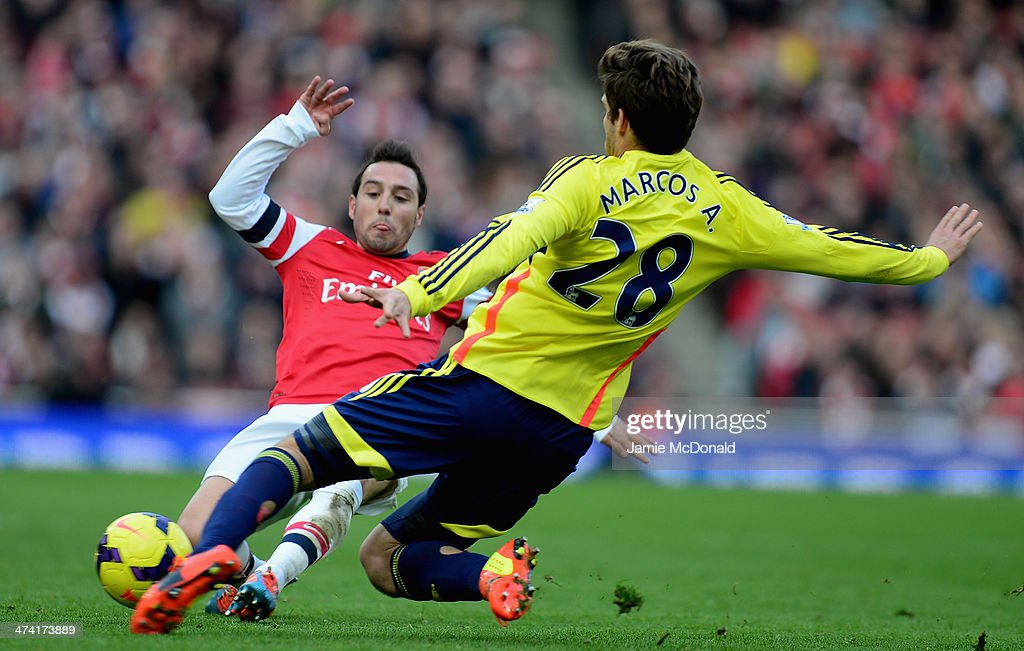 Santi Cazorla of Arsenal battles with Marcos Alonso of Sunderland during the Barclays Premier League match between Arsenal and Sunderland at Emirates Stadium on February 22, 2014 in London, England.
