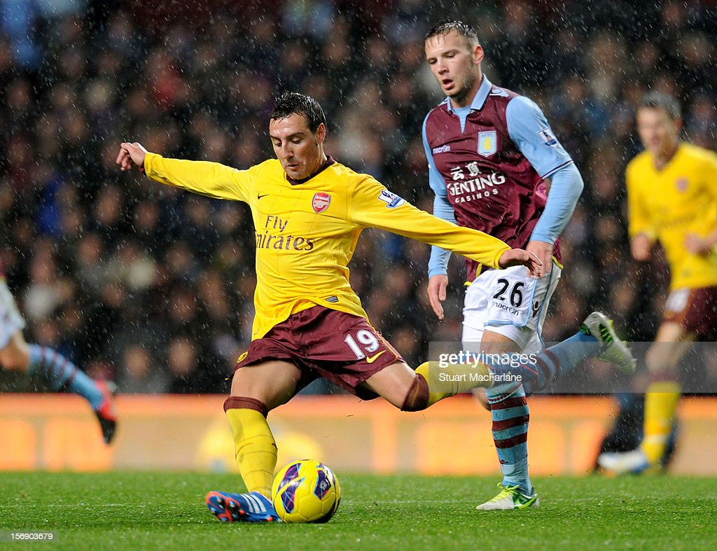 <a gi-track='captionPersonalityLinkClicked' href=/galleries/search?phrase=Santi+Cazorla&family=editorial&specificpeople=709830 ng-click='$event.stopPropagation()'>Santi Cazorla</a> of Arsenal breaks past <a gi-track='captionPersonalityLinkClicked' href=/galleries/search?phrase=Andreas+Weimann&family=editorial&specificpeople=5891558 ng-click='$event.stopPropagation()'>Andreas Weimann</a> of Aston Villa during the Barclays Premier League match between Aston Villa and Arsenal at Villa Park on November 24, 2012 in Birmingham, England.