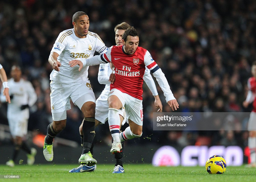 <a gi-track='captionPersonalityLinkClicked' href=/galleries/search?phrase=Santi+Cazorla&family=editorial&specificpeople=709830 ng-click='$event.stopPropagation()'>Santi Cazorla</a> of Arsenal breaks past Ashley Williams of Swansea during the Barclays Premier League match between Arsenal and Swansea City, at Emirates Stadium on December 01, 2012 in London, England.