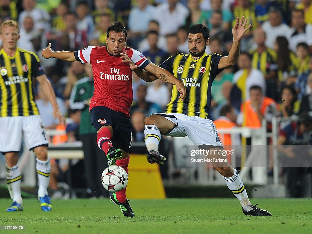 Santi Cazorla of Arsenal breaks past Bekir Irtgun of Fenerbache during the UEFA Champions League Play Off first leg match between Fenerbache SK and Arsenal FC at sukru Saracoglu Stadium on August 21, 2013 in Istanbul, Turkey.
