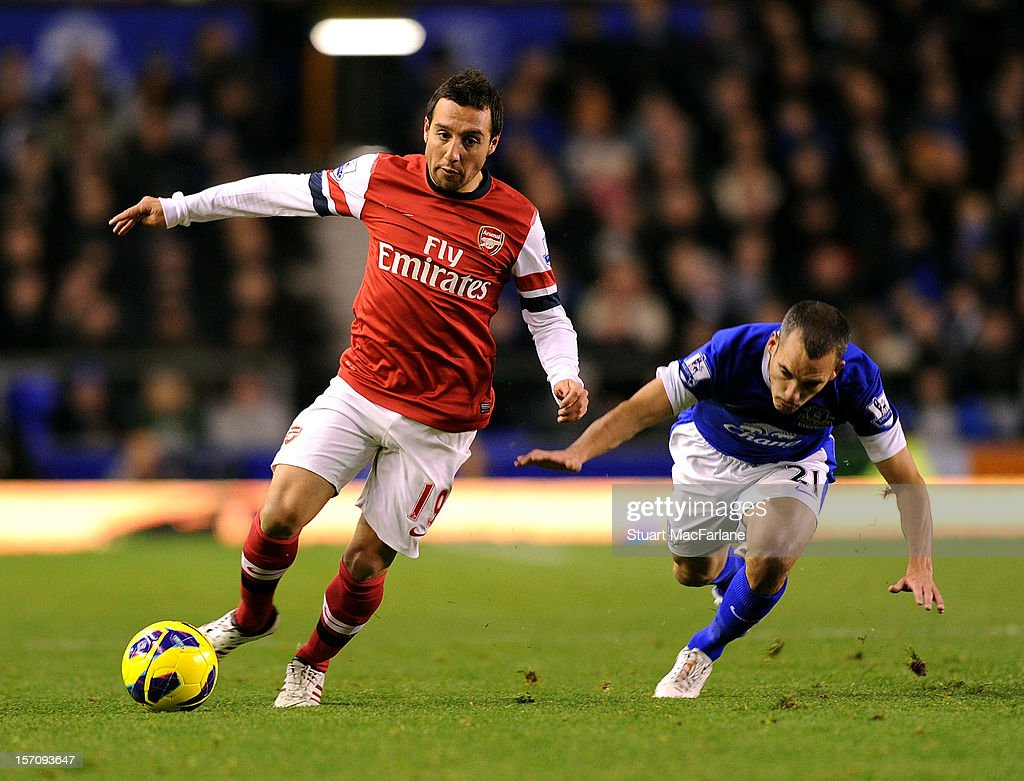 Santi Cazorla of Arsenal breaks past Bryan Oviedo of Everton during the Barclays Premier League match between Everton and Arsenal at Goodison Park on November 28, 2012 in Liverpool, England.