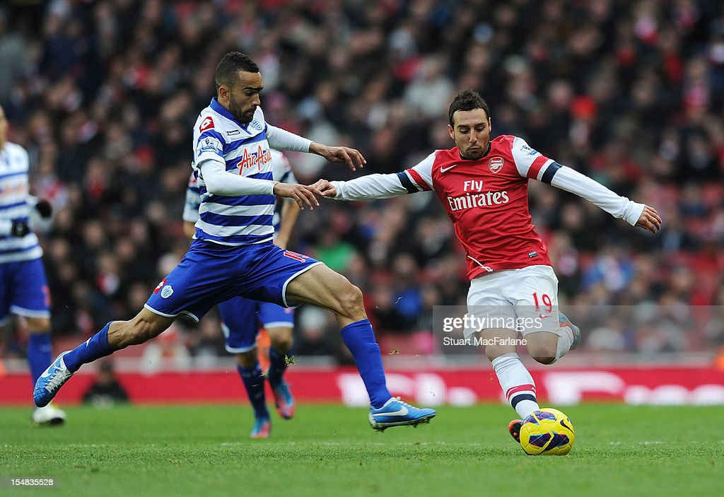 <a gi-track='captionPersonalityLinkClicked' href=/galleries/search?phrase=Santi+Cazorla&family=editorial&specificpeople=709830 ng-click='$event.stopPropagation()'>Santi Cazorla</a> of Arsenal breaks past <a gi-track='captionPersonalityLinkClicked' href=/galleries/search?phrase=Jose+Bosingwa&family=editorial&specificpeople=734722 ng-click='$event.stopPropagation()'>Jose Bosingwa</a> of QPR during the Barclays Premier League match between Arsenal and Queens Park Rangers, at Emirates Stadium on October 27, 2012 in London, England.