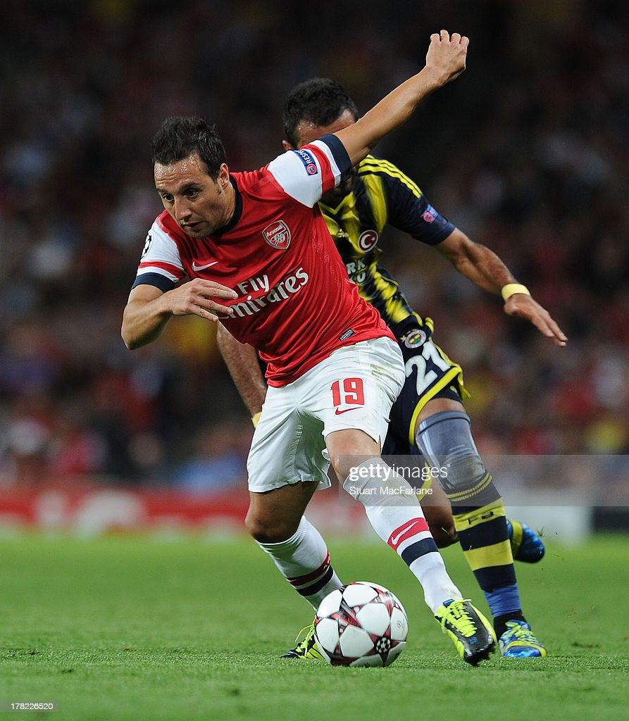 <a gi-track='captionPersonalityLinkClicked' href=/galleries/search?phrase=Santi+Cazorla&family=editorial&specificpeople=709830 ng-click='$event.stopPropagation()'>Santi Cazorla</a> of Arsenal brekas past Selcuk Sahin of Fenerbahce during the UEFA Champions League Play Off Second leg match between Arsenal FC and Fenerbahce SK at Emirates Stadium on August 27, 2013 in London, England.