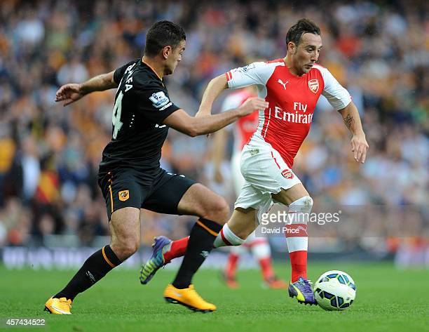 Santi Cazorla of Arsenal bursts past Hatem Ben Arfa of Hull during the match between Arsenal and Hull City in the Barclays Premier League at Emirates...
