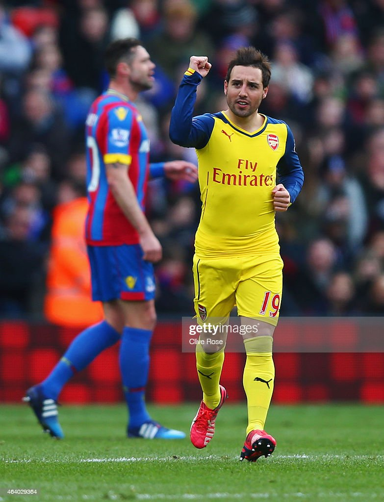 Santi Cazorla of Arsenal celebrates as he scores their first goal from a penalty during the Barclays Premier League match between Crystal Palace and Arsenal at Selhurst Park on February 21, 2015 in London, England.