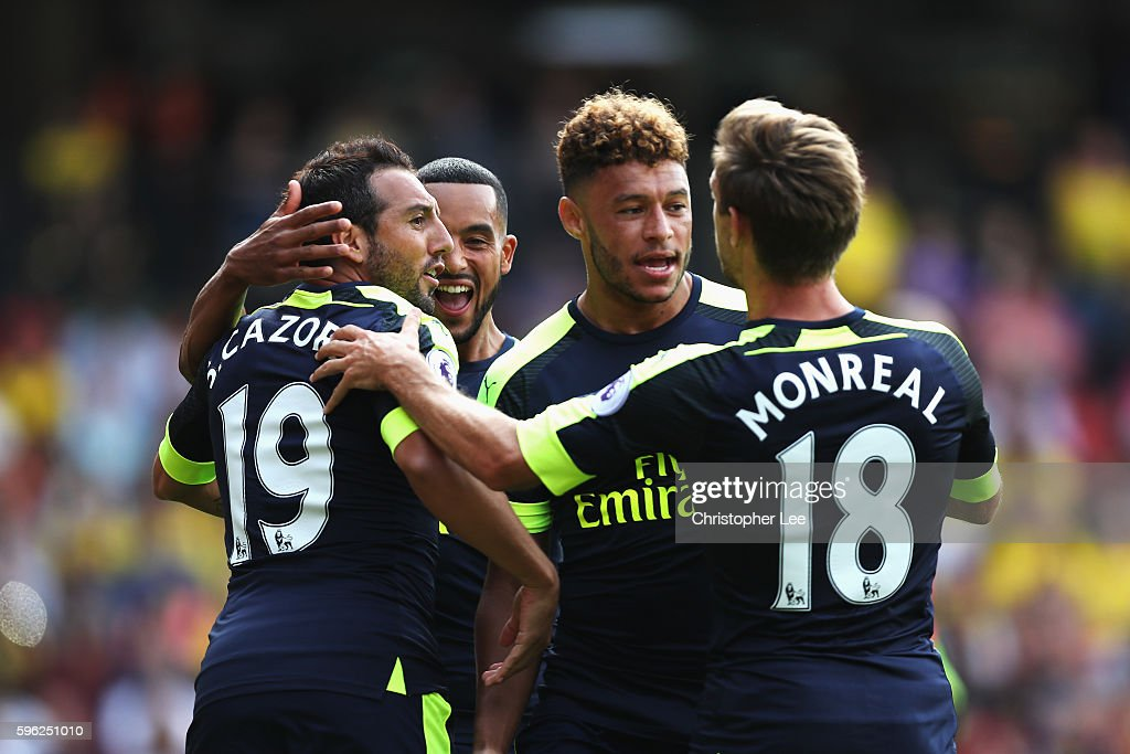Santi Cazorla of Arsenal celebrates scoring his sides first goal with his team mates during the Premier League match between Watford and Arsenal at...