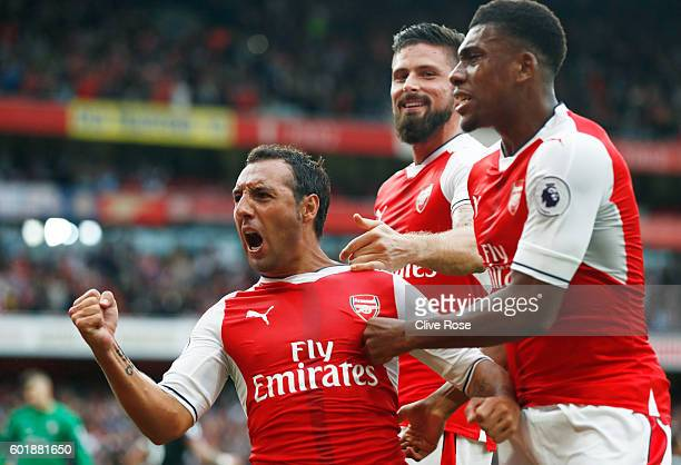 Santi Cazorla of Arsenal celebrates scoring his sides second goal with team mates during the Premier League match between Arsenal and Southampton at...