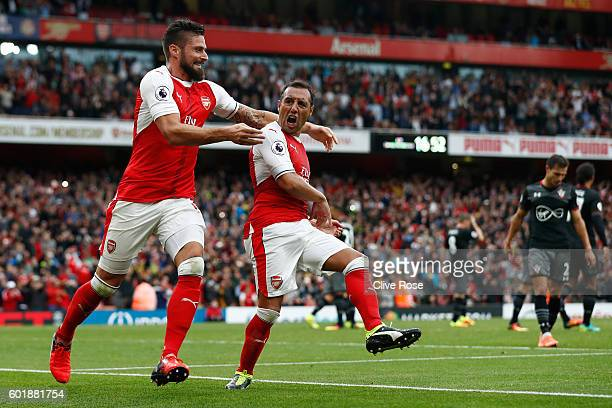 Santi Cazorla of Arsenal celebrates scoring his sides second goal with Olivier Giroud of Arsenal during the Premier League match between Arsenal and...