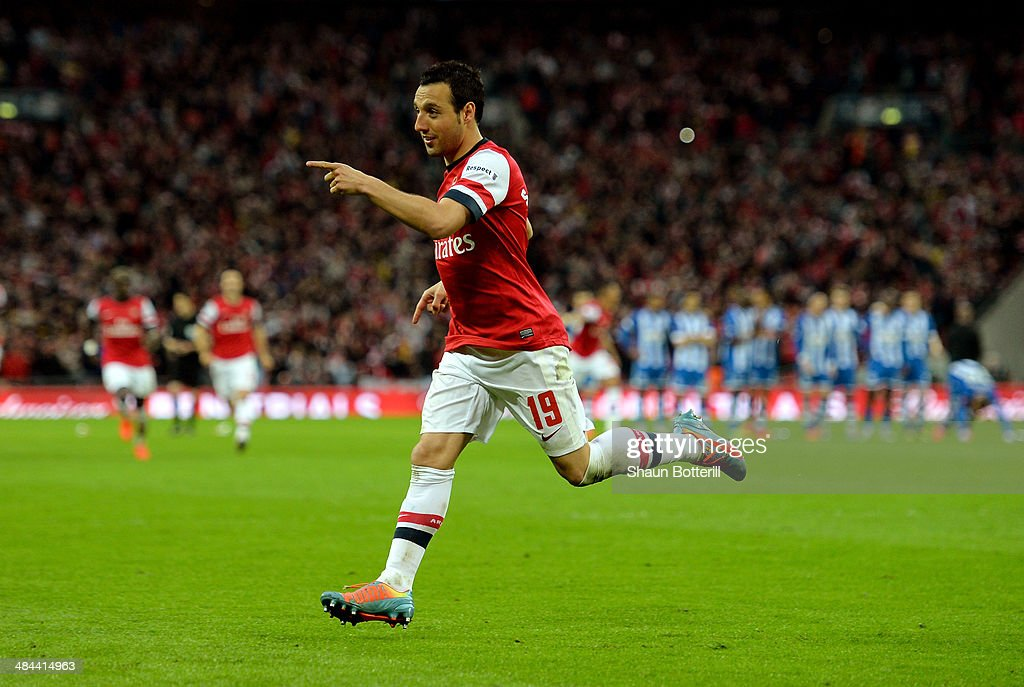 Santi Cazorla of Arsenal celebrates scoring the winning penalty during the shoot out during the FA Cup Semi-Final match between Wigan Athletic and Arsenal at Wembley Stadium on April 12, 2014 in London, England.