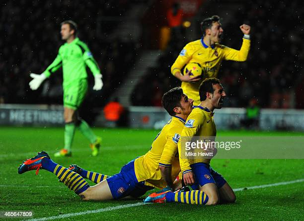 Santi Cazorla of Arsenal celebrates scoring their second goal with Olivier Giroud of Arsenal during the Barclays Premier League match between...