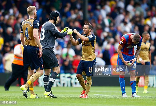Santi Cazorla of Arsenal celebrates victory with Petr Cech of Arsenal after the Barclays Premier League match between Crystal Palace and Arsenal at...