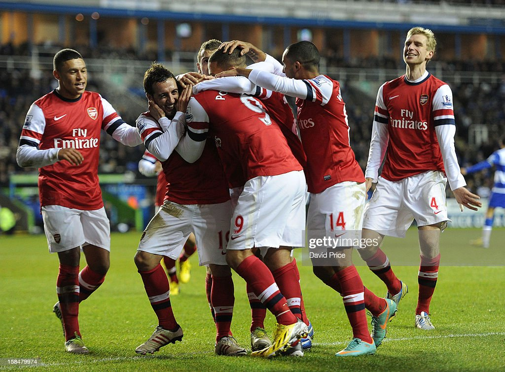 <a gi-track='captionPersonalityLinkClicked' href=/galleries/search?phrase=Santi+Cazorla&family=editorial&specificpeople=709830 ng-click='$event.stopPropagation()'>Santi Cazorla</a> of Arsenal celebrates with team-mates after scoring their third goal during the Barclays Premier League match between Reading and Arsenal at Madejski Stadium on December 17, 2012 in Reading, England.