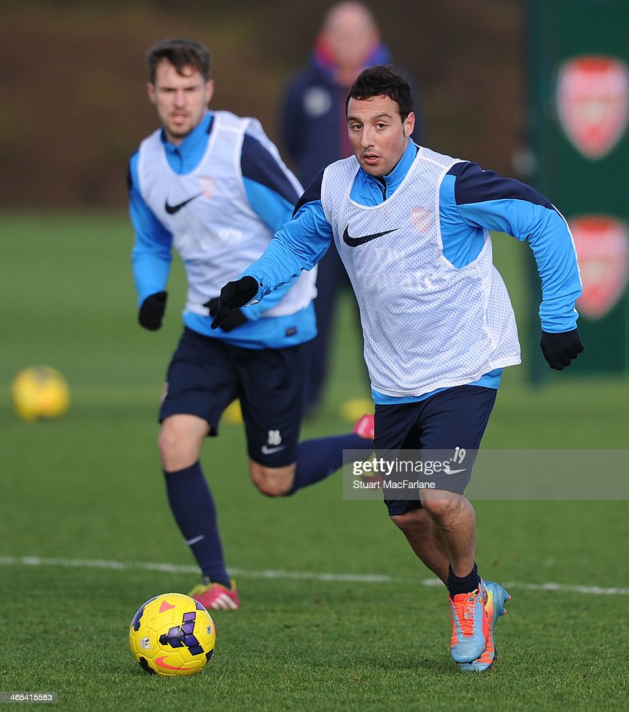 <a gi-track='captionPersonalityLinkClicked' href=/galleries/search?phrase=Santi+Cazorla&family=editorial&specificpeople=709830 ng-click='$event.stopPropagation()'>Santi Cazorla</a> of Arsenal during a training session at London Colney on January 27, 2014 in St Albans, England.