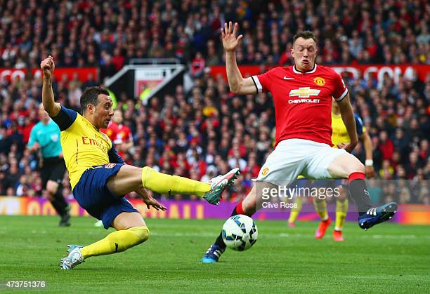 Santi Cazorla of Arsenal is blocked by Phil Jones of Manchester United during the Barclays Premier League match between Manchester United and Arsenal...