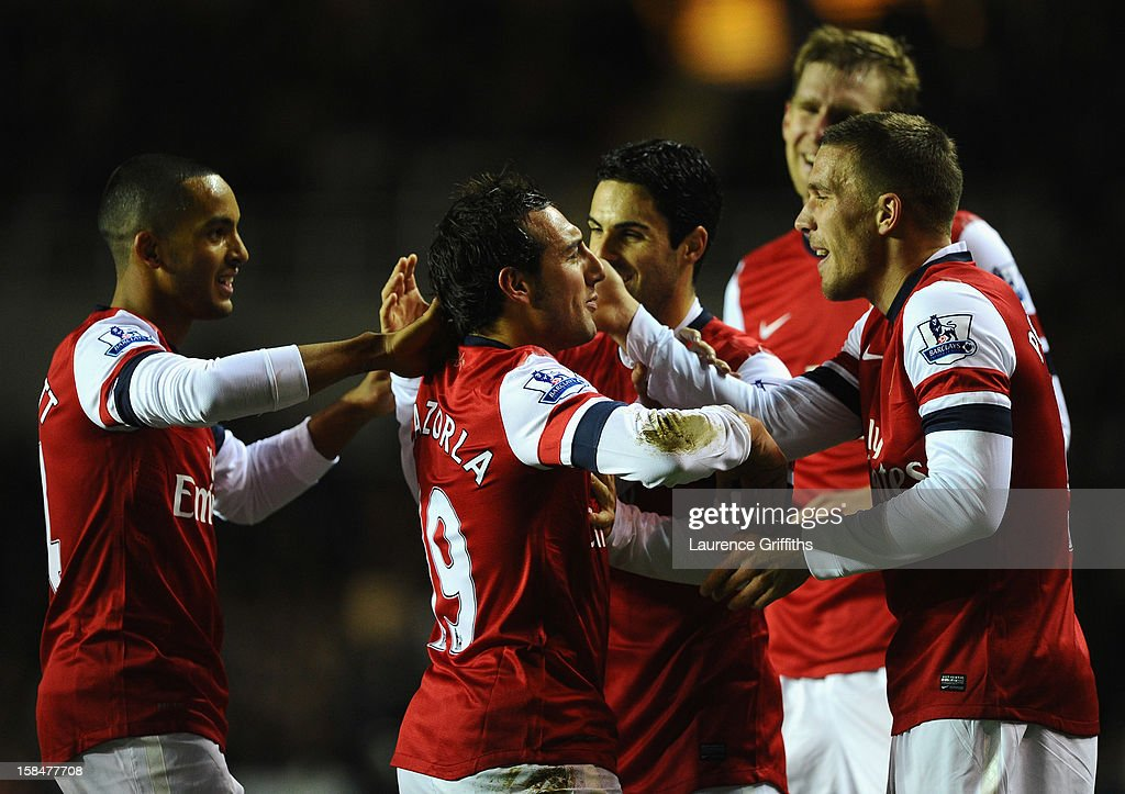 <a gi-track='captionPersonalityLinkClicked' href=/galleries/search?phrase=Santi+Cazorla&family=editorial&specificpeople=709830 ng-click='$event.stopPropagation()'>Santi Cazorla</a> of Arsenal is congratulated on scoring the second goal during the Barclays Premier League match between Reading and Arsenal at Madejski Stadium on December 17, 2012 in Reading, England.