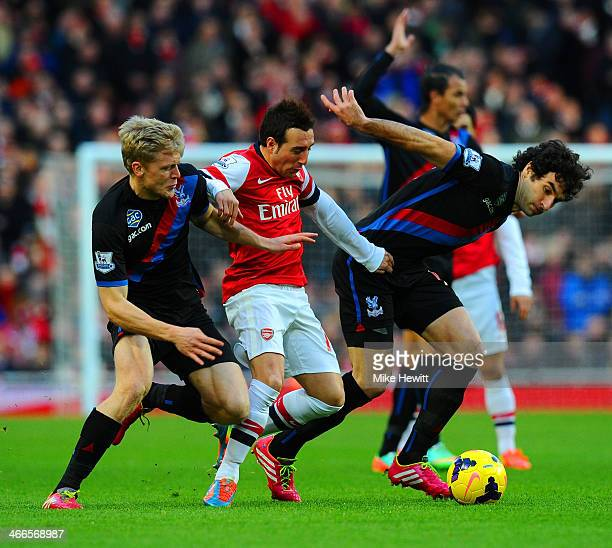 Santi Cazorla of Arsenal is marshalled by Jonathan Parr and Mile Jedinak of Crystal Palace during the Barclays Premier League match between Arsenal...