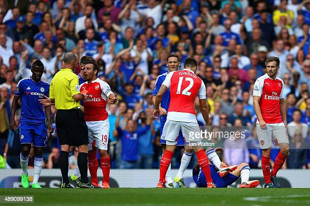 Santi Cazorla of Arsenal is shown a red card by referee Mike Dean during the Barclays Premier League match between Chelsea and Arsenal at Stamford...