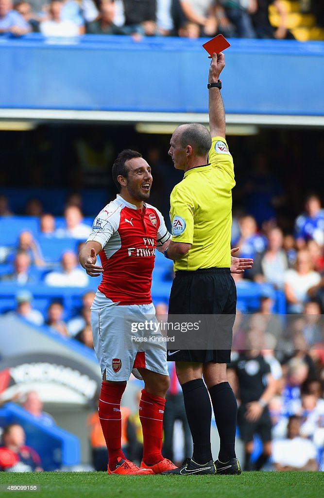 <a gi-track='captionPersonalityLinkClicked' href=/galleries/search?phrase=Santi+Cazorla&family=editorial&specificpeople=709830 ng-click='$event.stopPropagation()'>Santi Cazorla</a> of Arsenal is shown a red card by referee <a gi-track='captionPersonalityLinkClicked' href=/galleries/search?phrase=Mike+Dean+-+Referee&family=editorial&specificpeople=4517613 ng-click='$event.stopPropagation()'>Mike Dean</a> during the Barclays Premier League match between Chelsea and Arsenal at Stamford Bridge on September 19, 2015 in London, United Kingdom.