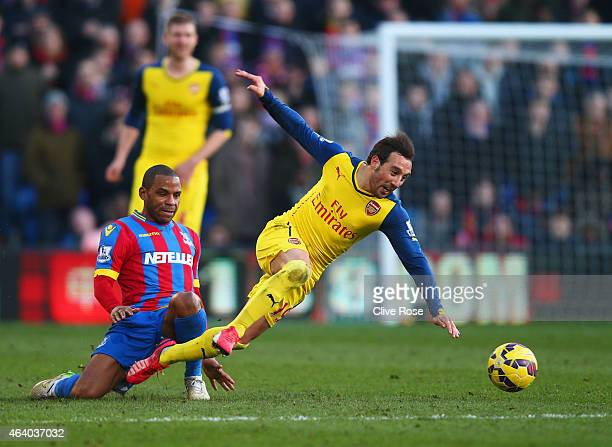 Santi Cazorla of Arsenal is tripped by Jason Puncheon of Crystal Palace during the Barclays Premier League match between Crystal Palace and Arsenal...