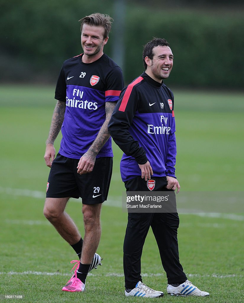 Santi Cazorla of Arsenal laughs with David Beckham during a training session at London Colney on January 29, 2013 in St Albans, England.