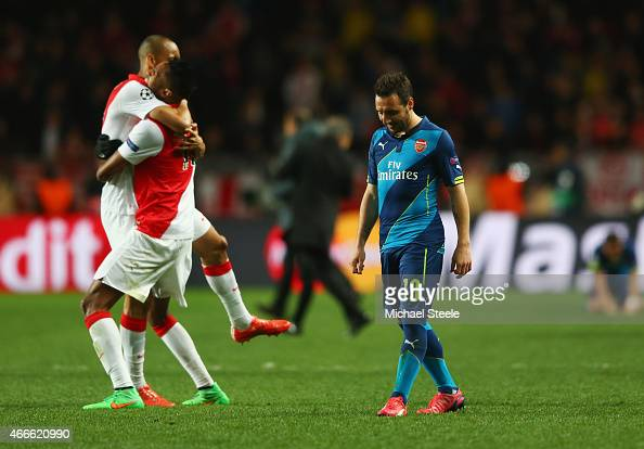 Santi Cazorla of Arsenal looks dejected as Monaco players celebrate qualifying for the next round after the UEFA Champions League round of 16 second...