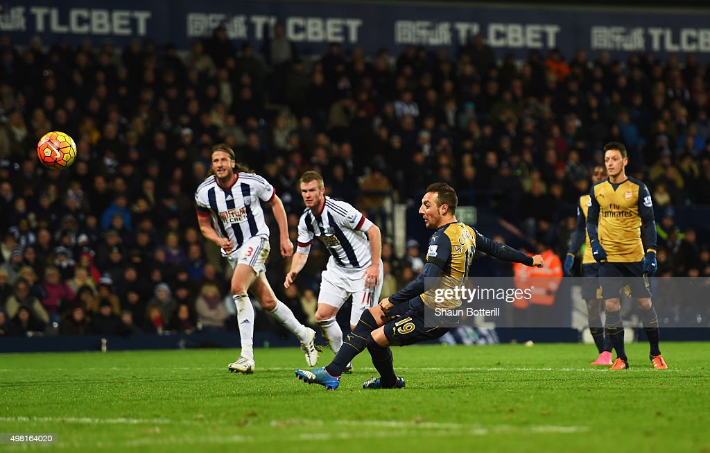 Santi Cazorla of Arsenal misses the penalty kick during the Barclays Premier League match between West Bromwich Albion and Arsenal at The Hawthorns on November 21, 2015 in West Bromwich, England.