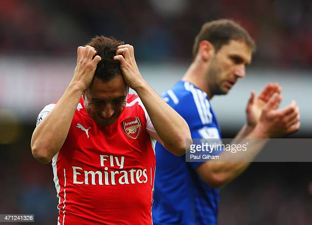 Santi Cazorla of Arsenal reacts after a missed chance during the Barclays Premier League match between Arsenal and Chelsea at Emirates Stadium on...