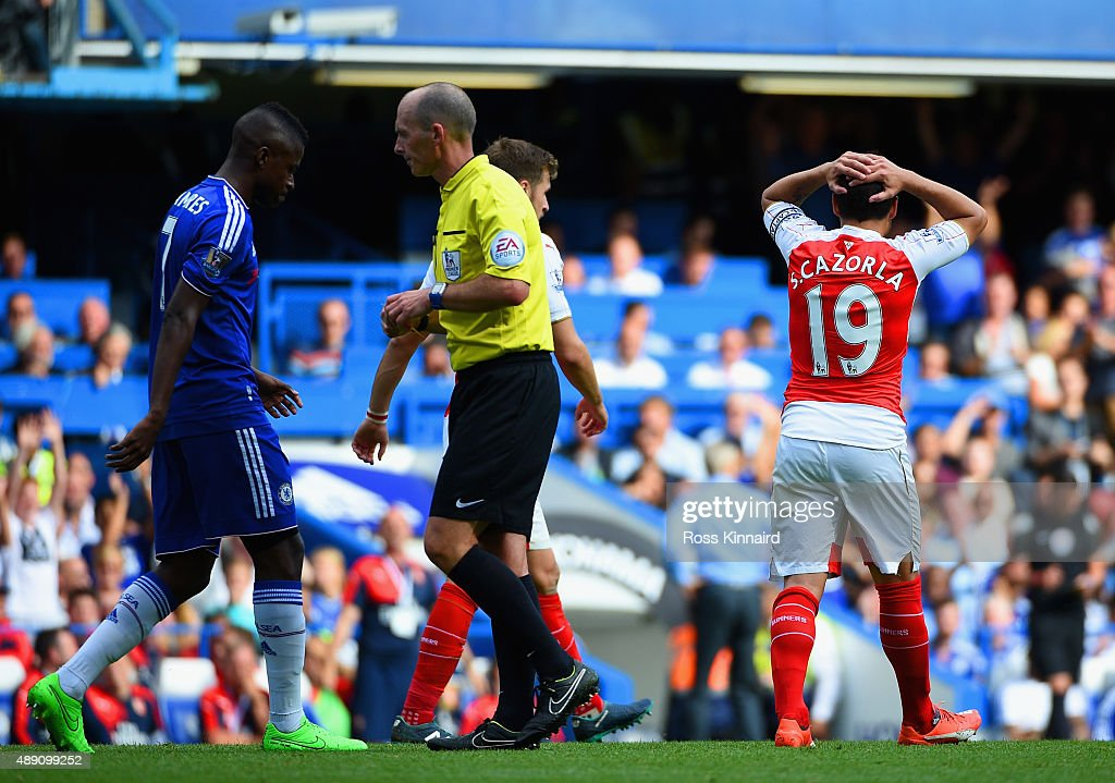 Santi Cazorla of Arsenal reacts after being shown a red card by referee Mike Dean during the Barclays Premier League match between Chelsea and Arsenal at Stamford Bridge on September 19, 2015 in London, United Kingdom.