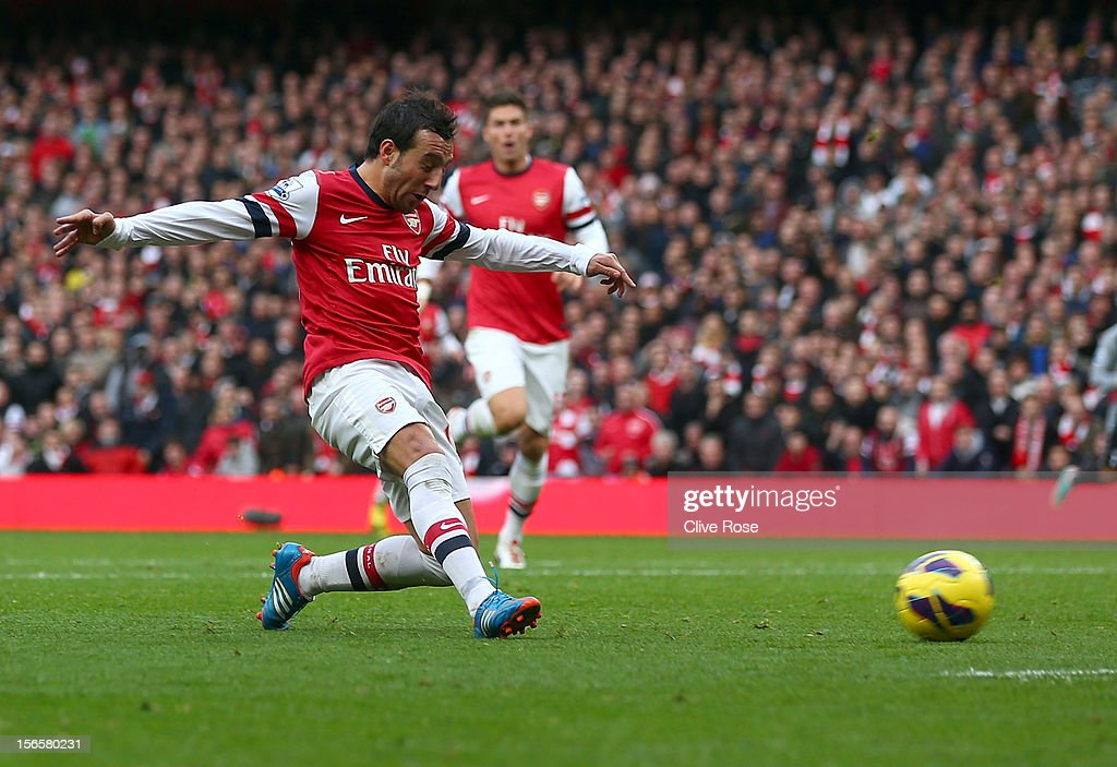 Santi Cazorla of Arsenal scores his team's fourth goal during the Barclays Premier league match between Arsenal and Tottenham Hotspur at Emirates Stadium on November 17, 2012 in London, England.