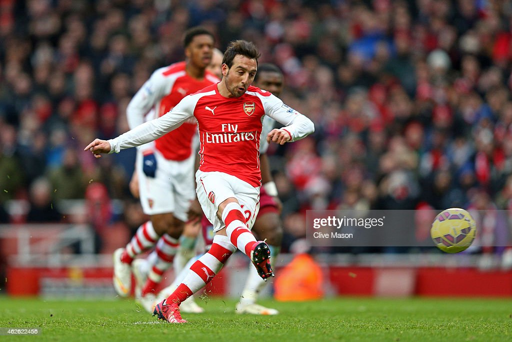 Santi Cazorla of Arsenal scores his team's fourth goal from the penalty spot during the Barclays Premier League match between Arsenal and Aston Villa at the Emirates Stadium on February 1, 2015 in London, England.