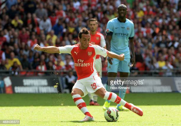 Santi Cazorla of Arsenal scores the opening goal during the FA Community Shield match Manchester City and Arsenal at Wembley Stadium on August 10...