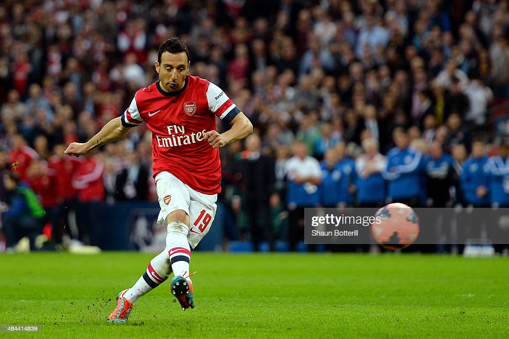 <a gi-track='captionPersonalityLinkClicked' href=/galleries/search?phrase=Santi+Cazorla&family=editorial&specificpeople=709830 ng-click='$event.stopPropagation()'>Santi Cazorla</a> of Arsenal scores the winning penalty during the shoot out during the FA Cup Semi-Final match between Wigan Athletic and Arsenal at Wembley Stadium on April 12, 2014 in London, England.
