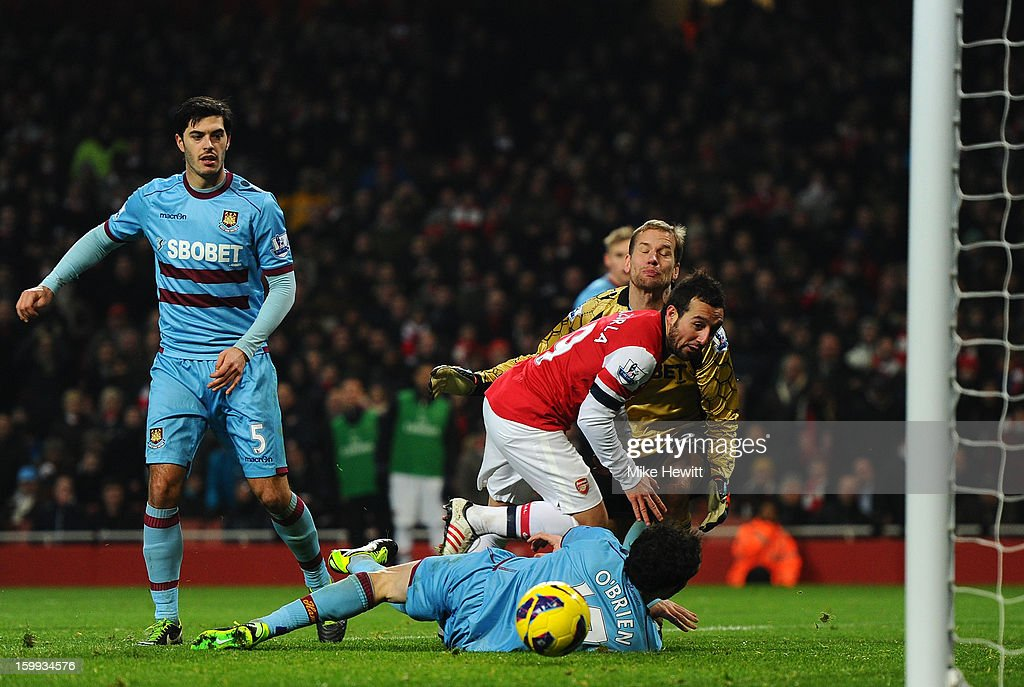<a gi-track='captionPersonalityLinkClicked' href=/galleries/search?phrase=Santi+Cazorla&family=editorial&specificpeople=709830 ng-click='$event.stopPropagation()'>Santi Cazorla</a> of Arsenal scores their thord goal during the Barclays Premier League match between Arsenal and West Ham United at Emirates Stadium on January 23, 2013 in London, England.