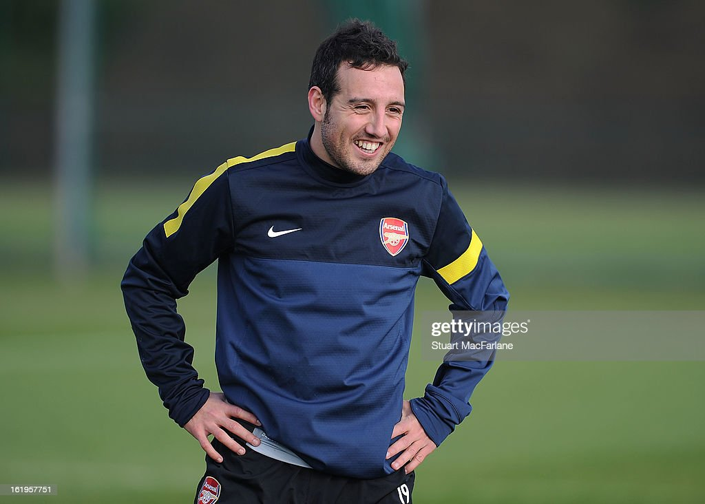 <a gi-track='captionPersonalityLinkClicked' href=/galleries/search?phrase=Santi+Cazorla&family=editorial&specificpeople=709830 ng-click='$event.stopPropagation()'>Santi Cazorla</a> of Arsenal smiles during a training session ahead of their UEFA Champions League match against FC Bayern Muenchen at London Colney on February 18, 2013 in St Albans, England.