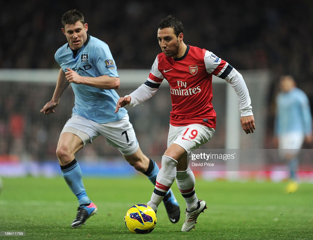<a gi-track='captionPersonalityLinkClicked' href=/galleries/search?phrase=Santi+Cazorla&family=editorial&specificpeople=709830 ng-click='$event.stopPropagation()'>Santi Cazorla</a> of Arsenal takes on <a gi-track='captionPersonalityLinkClicked' href=/galleries/search?phrase=James+Milner&family=editorial&specificpeople=214576 ng-click='$event.stopPropagation()'>James Milner</a> of Manchester City during the Barclays Premier League match between Arsenal and Manchester City at Emirates Stadium on January 13, 2013 in London, England.