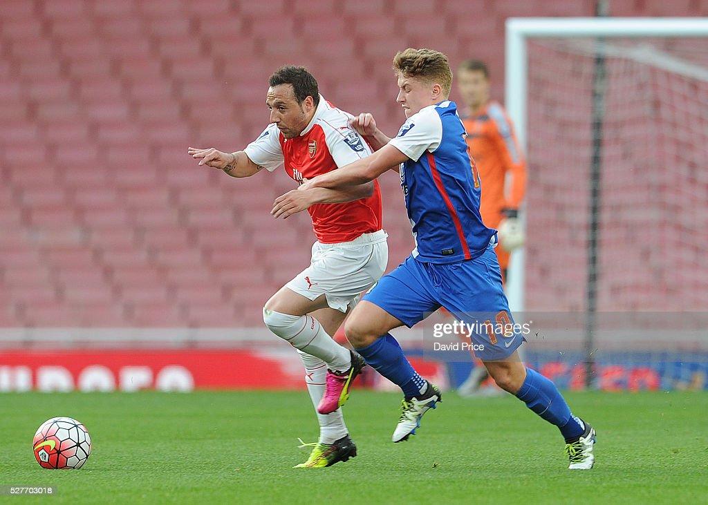 Santi Cazorla of Arsenal takes on Lewis Hardcastle of Blackburn during the match between Arsenal U21 and Blackburn Rovers U21 at Emirates Stadium on May 3, 2016 in London, England.