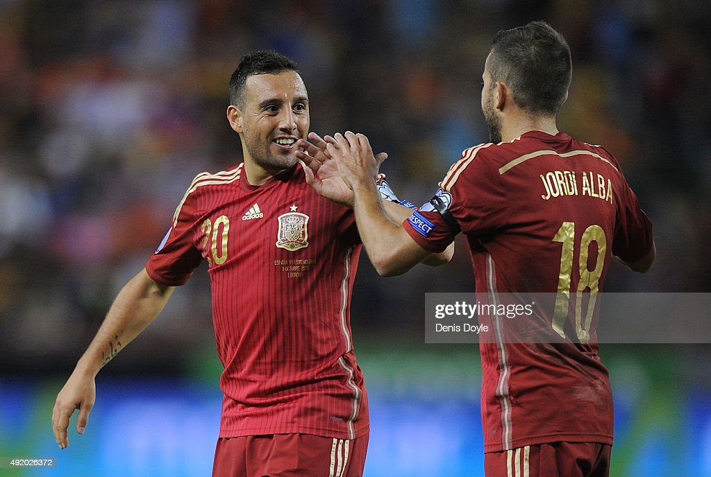 Santi Cazorla of Spain celebrates with Jordi Alba after scoring Spain's opening goal during the UEFA EURO 2016 Qualifier group C match between Spain...
