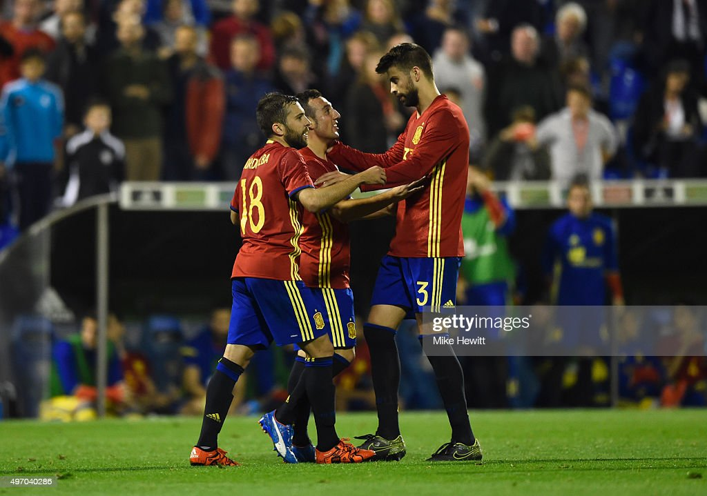 Santi Cazorla of Spain celebrates with Jordi Alba and Gerard Pique as he scores their second goal during the international friendly match between...