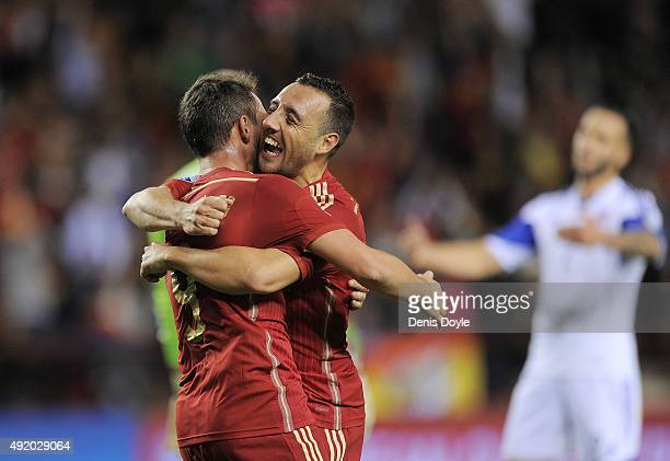 Santi Cazorla of Spain celebrates with Paco Alcacer after Alcacer scored his team's 2nd goal during the UEFA EURO 2016 Qualifier group C match...