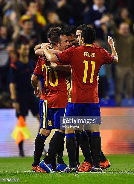 Santi Cazorla of Spain celebrates with team mates as he scores their second goal during the international friendly match between Spain and England at...