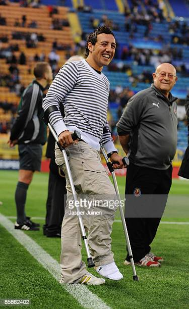 Santi Cazorla of Villarreal appears on crutches during the UEFA Champions League quarterfinal first leg match between Villarreal and Arsenal at the...