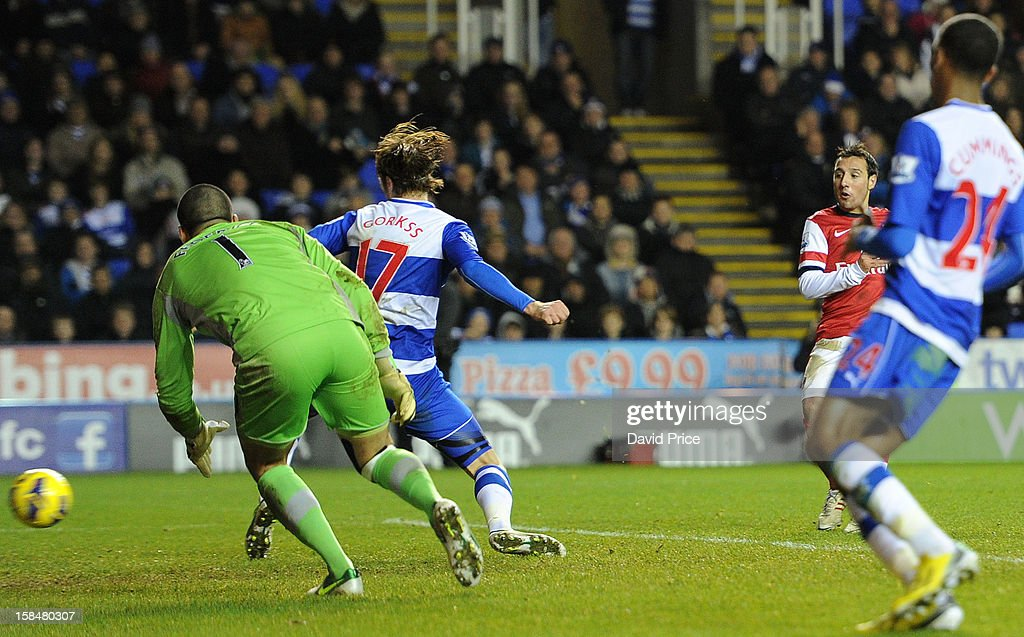 Santi Cazorla scores his 3rd goal for Arsenal past Kaspars Gorkss and Adam Federici of Reading during the Barclays Premier League match between Reading and Arsenal at Madejski Stadium on December 17, 2012 in Reading, England.