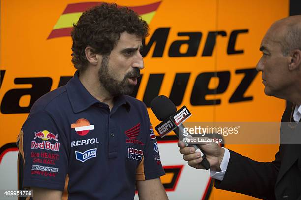 Santi Hernandez of Spain and Chief Mechanic of Marc Marquez and Repsol Team Honda speaks with journalists in paddock during the MotoGp of Argentina...