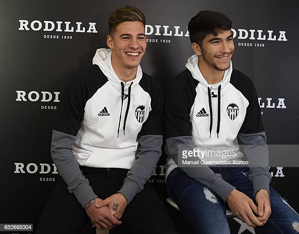 Santi Mina and Carlos Soler players of Valencia CF attend the Rodilla opening on January 25 2017 in Valencia Spain