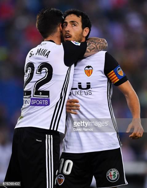 Santi Mina and Dani Parejo of Valencia CF celebrate after Geoffrey Kondogbia of Valencia CF scored the opening goal past Pablo Piatti and Javi Fuego...