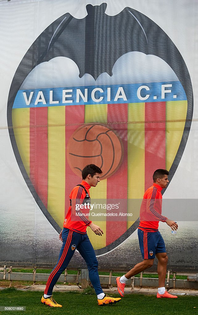 Santi Mina (L) and Joao Cancelo of Valencia arrive for a Valencia CF training session ahead of Wednesday's Copa del Rey Semi Final, second leg match between Valencia CF and FC Barcelona at Paterna Training Centre on February 9, 2016 in Valencia, Spain.