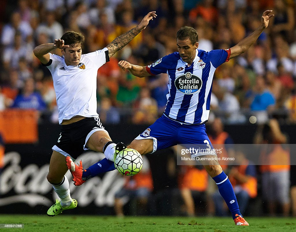 Santi Mina of Valencia battle for the ball with Fernando Navarro of Deportivo during the La Liga match between Valencia CF and RC Deportivo de La...