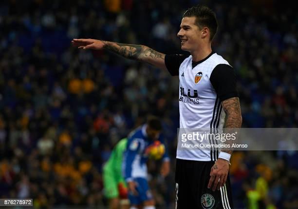 Santi Mina of Valencia celebrates scoring his team's second goal during the La Liga match between Espanyol and Valencia at CornellaEl Prat stadium on...